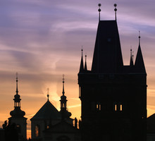 Silhouettes of Prague towers at dawn