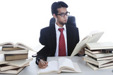 Busy businessman working with books