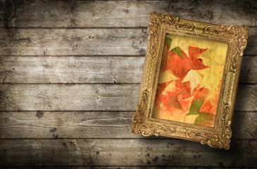 quadro autunnale contro parete di legno