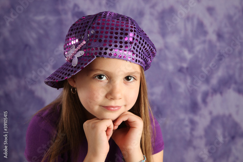 Cute young girl wearing a purple hat