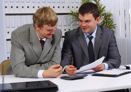 business partners over papers discussing them