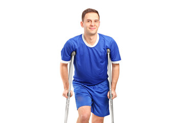 An injured soccer football player on crutches