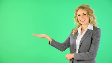 Smiling businesswoman presenting product advantages