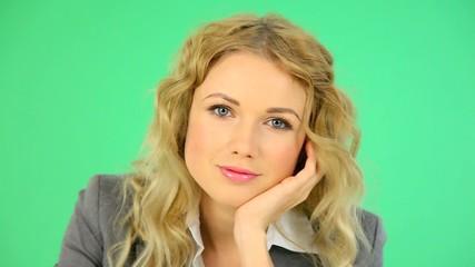 Portrait of businesswoman on green background