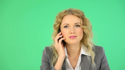 Portrait of beautiful businesswoman talking on the phone