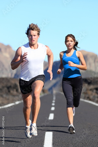 Running young couple
