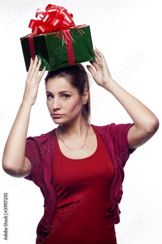 Pretty young woman with present on her head