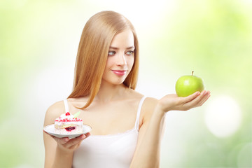 girl holding a cake and apple