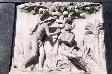 Adam and Eve - bas relief sculpture on a grave