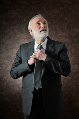 a man fixes his tie