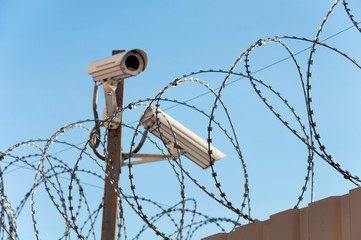 Camera surveillance and barbed wire