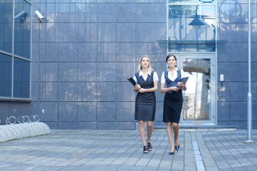 Two young businesswomen in formal clothes