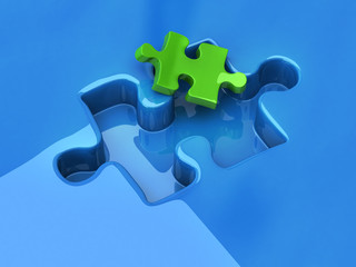 Small green jigsaw puzzle piece