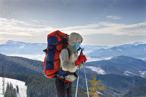 Young woman hiker hiking in Karpatian