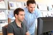 Workmates in office in front of desktop