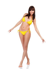 Voluptuous woman in yellow swimsuit smiling to you