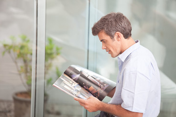 Designer browsing a design book