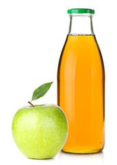 Apple juice in a glass bottle and ripe apple