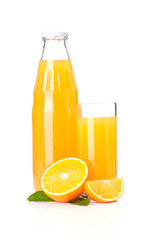 Orange juice glass bottle and oranges.