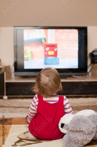 child watches television
