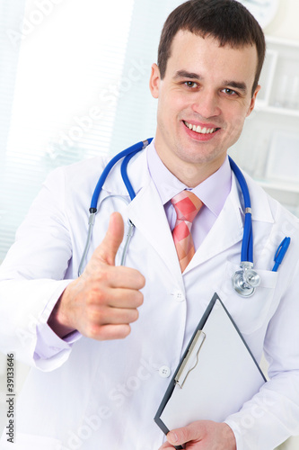 male doctor with gesture OK