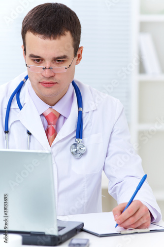 doctor working with a laptop