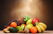Assortment of exotic fruits on wooden table on brown background