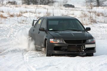 Black car on snowy road