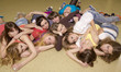 The big group of girls lies on a floor