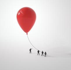 Tiny people holding a balloon