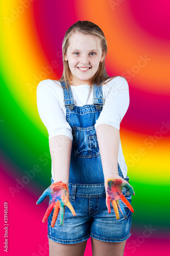 young happy girl. Child hands painted in colorful paints.