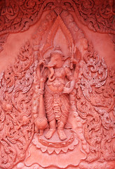red stucco , thai style on the Wall