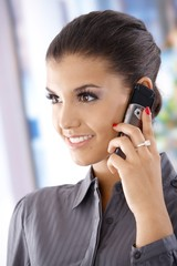 Attractive smiling woman on mobile