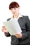 Business woman reads documents