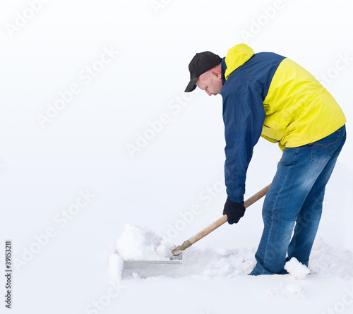 Man digging a path from the snow