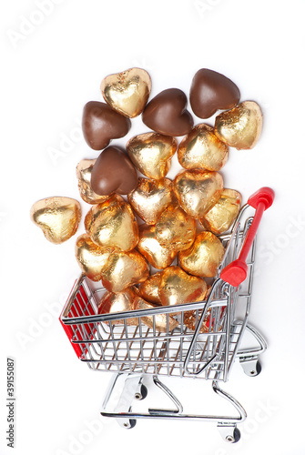 Gold foil wrapped chocolate hearts and shopping cart