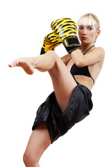 Boxing blond woman