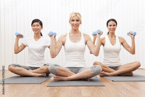 Interracial Yoga Group of Three Women Weight Training