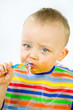 Infant Eating with food round his Face