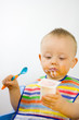 Infant Eating Yoghurt Messily