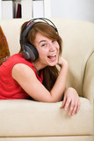 Beautiful teenage girl listening to music