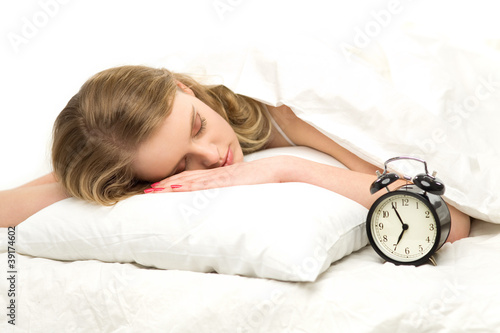 Sleeping woman with alarm clock