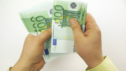 Person counting money (100 euro bills)