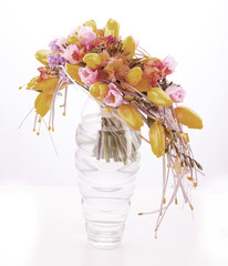 Colorful flower arrangement in glass vase with yellow tulips