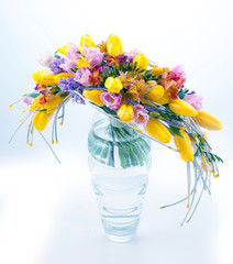 Fresh festive bouquet of flowers in vase on white background
