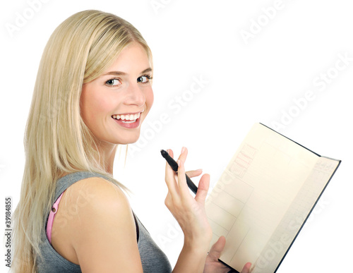 portrait of cute girl holding diary