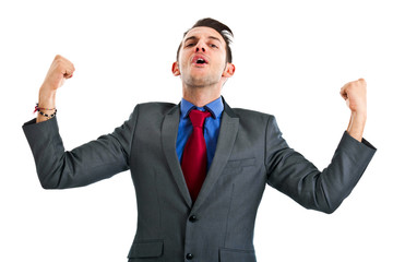 Victorious businessman with raised arms