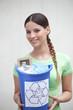Girl holding a trash bin