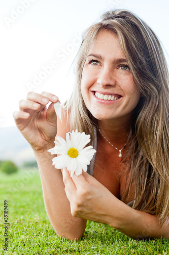 Naive woman with a flower