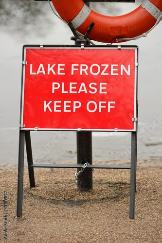 "Bright red ""Lake Frozen Please Keep Off"" warning sign"
